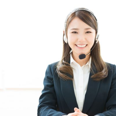 Asian woman with headset smiling