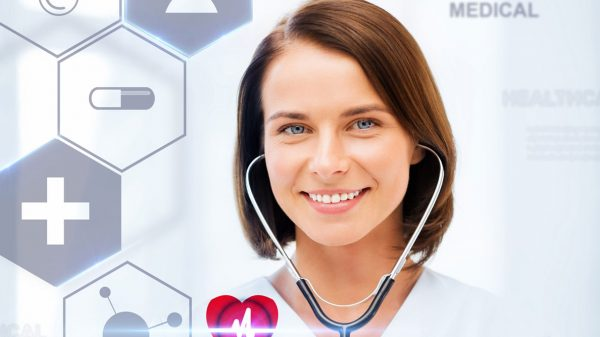 Photo of a smiling female doctor with stethoscope in ears